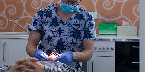 Orthodontist performing procedure
