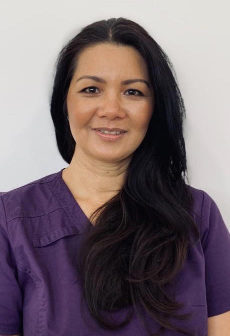 Linda from Oasis Orthodontics in a purple top